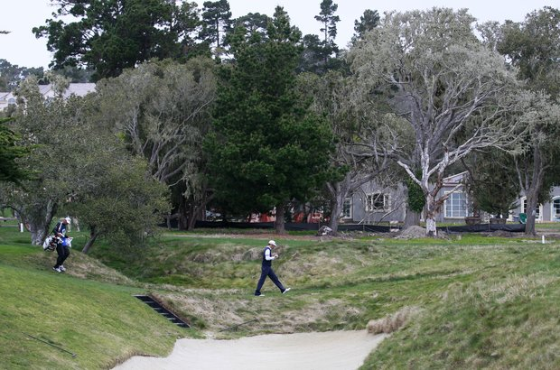 Dustin Johnson walks along the second fairway at Pebble Beach Golf Links during the final round of the AT&T Pebble Beach National Pro-Am golf tournament in Pebble Beach, Calif., Sunday, Feb. 12, 2012.