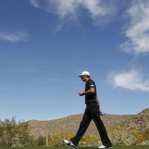 Dustin Johnson walks off the 10th tee during the Match Play Championship golf tournament, Thursday, Feb. 23, 2012, in Marana, Ariz.