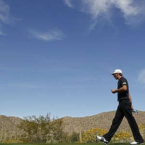 Dustin Johnson walks off the 10th tee during the Match Play Championship golf tournament, Thursday, Feb. 23, 2012, in Marana, Ariz.