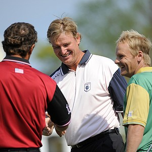 Team Albany's Ernie Els, center, of South Africa, congratulates Team Isleworth's Charles Howell III, left, and Team Queenwood's Soren Kjeldsen, of Denmark, after completing the 18th hole during the Tavistock Cup exhibition golf tournament at Lake Nona Golf & Country Club on Tuesday, March 20, 2012, in Orlando, Fla.