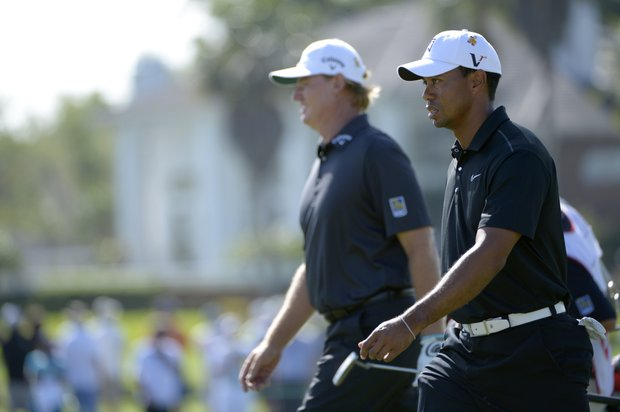 Tiger Woods, right, and Ernie Els, of South Africa, walk onto the 17th green during the first round of the Arnold Palmer Invitational golf tournament at Bay Hill in Orlando, Fla., Thursday, March 22, 2012.