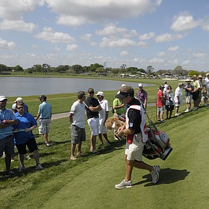 Ernie Els, right, of South Africa, walks off the fifth green after making his putt during the first round of the Arnold Palmer Invitational golf tournament at Bay Hill in Orlando, Fla., Thursday, March 22, 2012.
