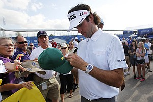 Bubba Watson signs autographs during the second round of the Zurich Classic golf tournament at TPC Louisiana in Avondale, La., Friday, April 27, 2012.