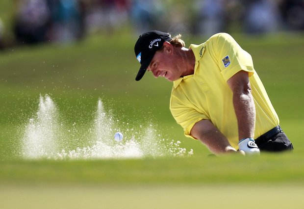 Ernie Els hits out of the sand onto the 18th green during the final round of the Zurich Classic golf tournament at TPC Louisiana in Avondale, La., Sunday, April 29, 2012. Els went on to lose a sudden death playoff against Jason Dufner.
