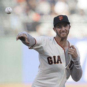 Golfer Dustin Johnson throws out the cermonial first pitch before a baseball game between the San Francisco Giants and the Houston Astros in San Francisco, Wednesday, June 13, 2012.