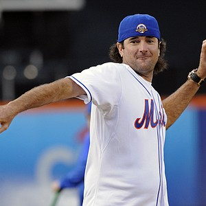 Golfer Bubba Watson throws out the first pitch of the New York Mets interleague baseball game against the Baltimore Orioles, Monday, June 18, 2012, at Citi Field in New York.