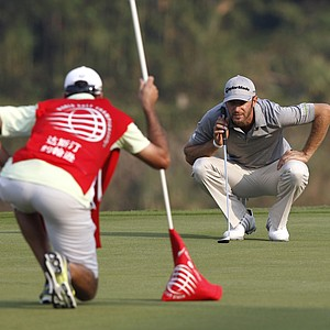 Dustin Johnson of the U.S. lines a putt at the 18th hole during the round 2 match of the HSBC Champions golf tournament in Dongguan, southern China's Guangdong province, Friday Nov. 2, 2012.