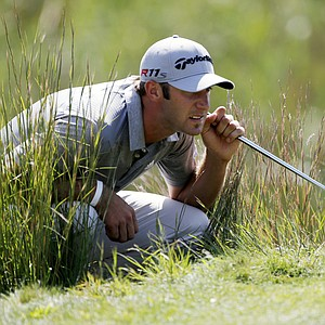 Dustin Johnson reads the green on the second hole during the final round of the Deutsche Bank Championship PGA golf tournament at TPC Boston in Norton, Mass., Monday, Sept. 3, 2012.