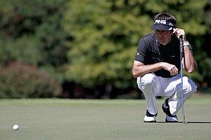 Bubba Watson eyes his putt on the fourth hole during the final round of the Tour Championship golf tournament on Sunday, Sept. 23, 2012, in Atlanta.