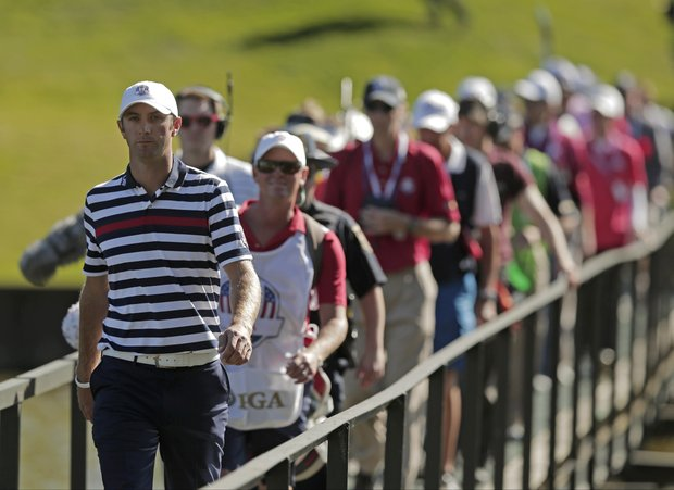 USA's Dustin Johnson walks across the bridge on the 13th hole during a singles match at the Ryder Cup PGA golf tournament Sunday, Sept. 30, 2012, at the Medinah Country Club in Medinah, Ill.