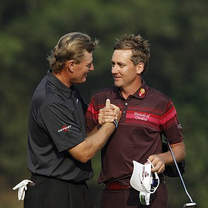 Ian Poulter from England, right, shakes hands with Ernie Els from South Africa on the 18th hole after winning the HSBC Champions golf tournament in Dongguan, southern China's Guangdong province, Sunday Nov. 4, 2012.