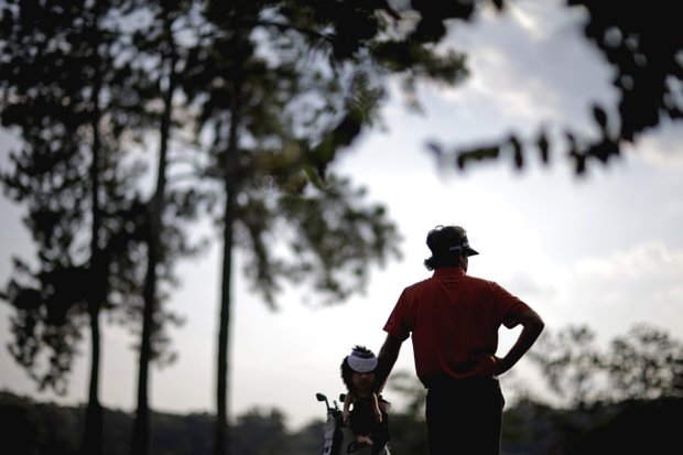Bubba Watson stands on the green of the 17th hole during the third round of the Tour Championship golf tournament Saturday, Sept. 22, 2012, in Atlanta.