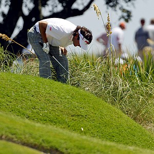 Bubba Watson looks at his lie on the second hole during the first round of the PGA Championship golf tournament on the Ocean Course of the Kiawah Island Golf Resort in Kiawah Island, S.C., Thursday, Aug. 9, 2012.