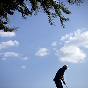 Dustin Johnson prepares to putt on the 17th hole during the third round of the Tour Championship golf tournament Saturday, Sept. 22, 2012, in Atlanta.