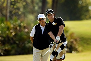 Meaghan Francella gets in a little practice on Tuesday of LPGA Q-School at LPGA International with her instructor, Gale Peterson of Sea Island.