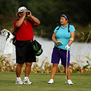 Christina Kim with her father/caddie Man Kim at No. 18 on Tuesday of LPGA Q-School at LPGA International.