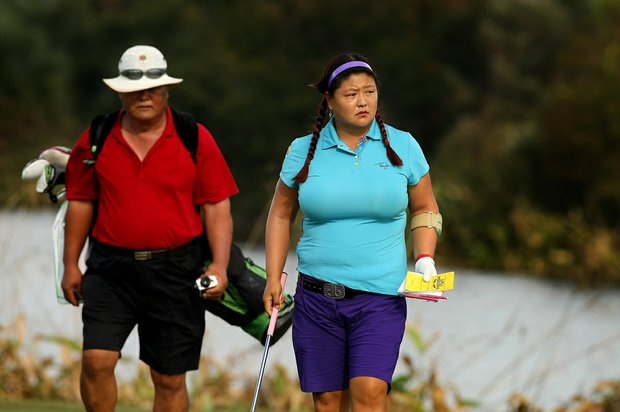 Christina Kim, right, with her father/caddie Man Kim at No. 18 of the Champions Course on Tuesday of LPGA Q-School at LPGA International.