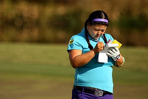 Christina Kim takes notes at No. 18 of the Champions Course on Tuesday of LPGA Q-School at LPGA International.