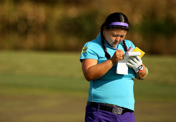 Christina Kim takes notes at No. 18 of the Champions Course on Tuesday of LPGA Q-School at LPGA International.