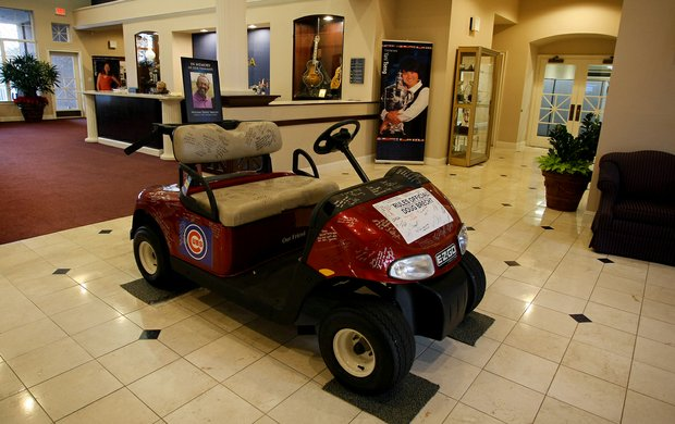 A golf cart signed by many sits in the lobby of LPGA headquarters in memorial of rules official Doug Brecht on Tuesday of LPGA Q-School at LPGA International. Longtime rules official Doug Brecht passed away recently due to complications from meningitis associated with the West Nile Virus.