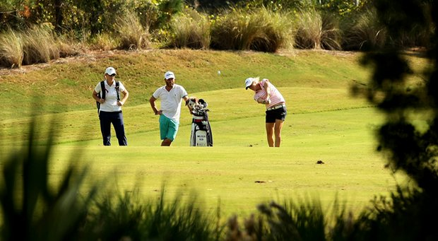 Melissa Reid of England with her caddie Johnny Scott and Annie Mallory of CoreGolf Academy during a practice round for LPGA Q-School.