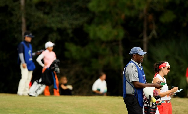 Kim Welch with her caddie at No. 10 on Legends course during Friday of LPGA Q-School. Welch started her round in 5th place.