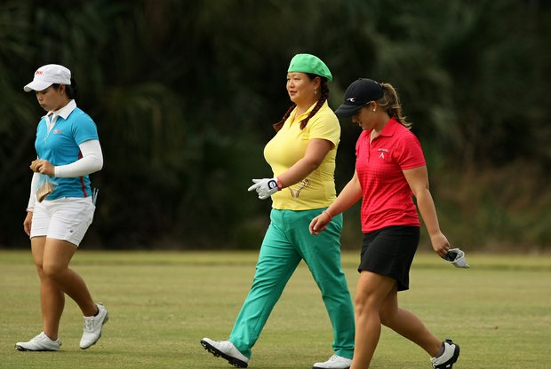 Christina Kim walks with Moriya Jutanugarn, left, and Lacy Agnew on the Legends course during Friday of LPGA Q-School.