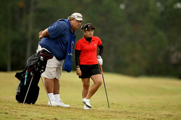 Moriya Jutanugarn with her caddie Eric Bajas at No. 4 on Champions course during Saturday of LPGA Q-School. Jutanugarn is leading the tournament by six shots after the fourth round.