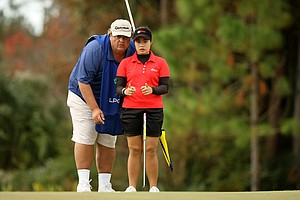 Moriya Jutanugarn and her caddie Eric Bajas at No. 4 on Champions course during Saturday of LPGA Q-School. Jutanugarn still holds a six shot lead.