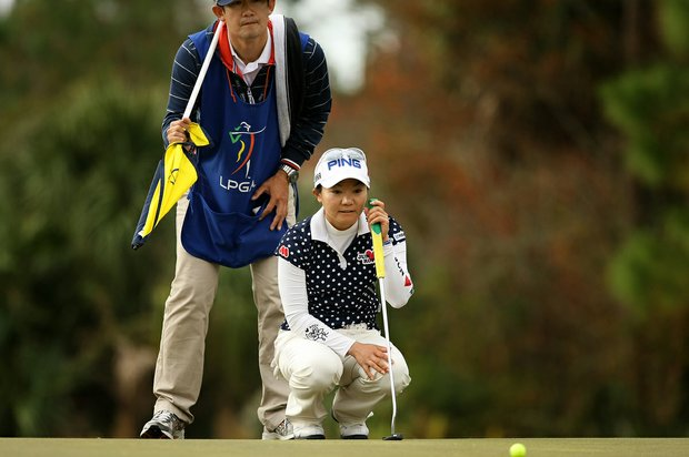 Ayako Uehara of Japan lines up her putt at No. 4 on Champions course during Saturday of LPGA Q-School.