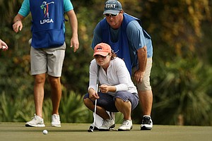 Candace Schepperle with her father/caddie Dave at No. 18 on the Legends course during Saturday of LPGA Q-School. Schepperle missed the cut.
