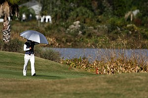 Ayako Uehara of Japan walks up No. 18 on Champions course during Saturday of LPGA Q-School.