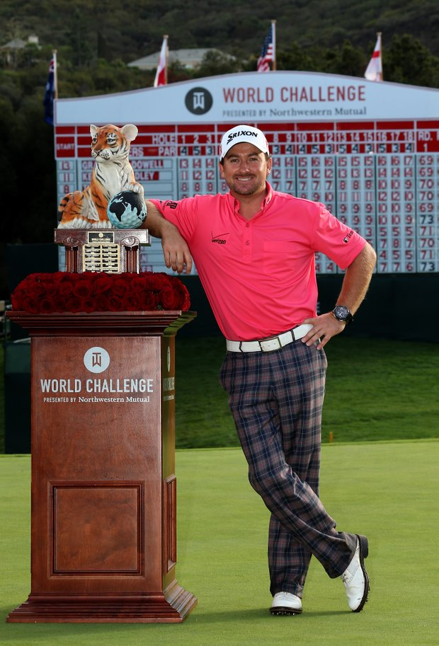 Graeme McDowell poses with the trophy after his three-stroke victory in the final round of the Tiger Woods World Challenge.