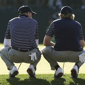 USA's Jim Furyk, left, and Brandt Snedeker wait to putt during a foursomes match at the Ryder Cup PGA golf tournament Saturday, Sept. 29, 2012, at the Medinah Country Club in Medinah, Ill.