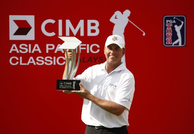 Bo Van Pelt of the United States poses with the trophy after winning the Asia Pacific Classic Malaysia golf tournament at the Mines Resort & Golf Club in Kuala Lumpur, Malaysia, Sunday, Oct. 30, 2011.