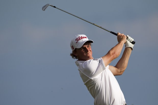Bud Cauley follows his shot off the 17th tee during the first round of the Sony Open golf tournament, Thursday, Jan. 12, 2012, in Honolulu.