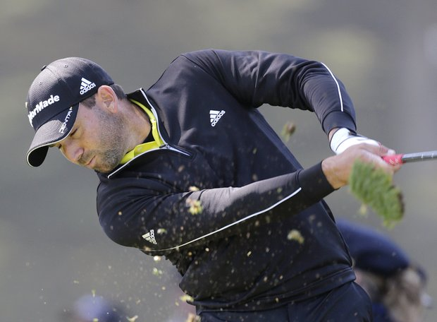 Sergio Garcia, of Spain, takes a divot on a shot during the second round of the U.S. Open Championship golf tournament Friday, June 15, 2012, at The Olympic Club in San Francisco.