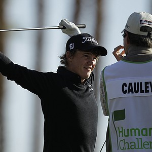 Bud Cauley, left, stretches on the 10th tee of the Jack Nicklaus Private Course at PGA West during the second round of the Humana Challenge PGA golf tournament Friday, Jan. 20, 2012, in La Quinta, Calif.