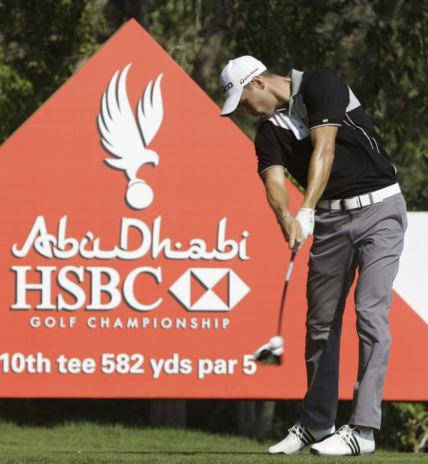 Martin Kaymer from Germany tees off on the 10th hole during the first round of the Abu Dhabi HSBC Golf Championship, Thursday, Jan. 26, 2012 in Abu Dhabi, United Arab Emirates.