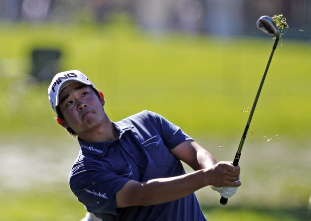 John Huh watches his chip on the sixth hole of the South Course at Torrey Pines during the third round of the Farmers Insurance Open golf tournament Saturday, Jan. 28, 2012 in San Diego.