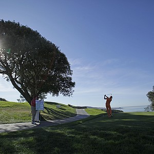 Rickie Fowler tees off on the par three third hole of the South Course at Torrey Pines during the final round of the Farmers Insurance Open golf tournament on Sunday, Jan. 29, 2012, in San Diego.