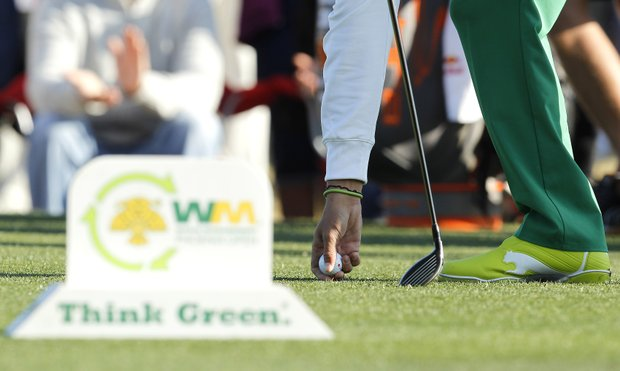 Rickie Fowler tees his ball up at the 11th hole during the first round of the Phoenix Open golf tournament Thursday, Feb. 2, 2012, in Scottsdale, Ariz.