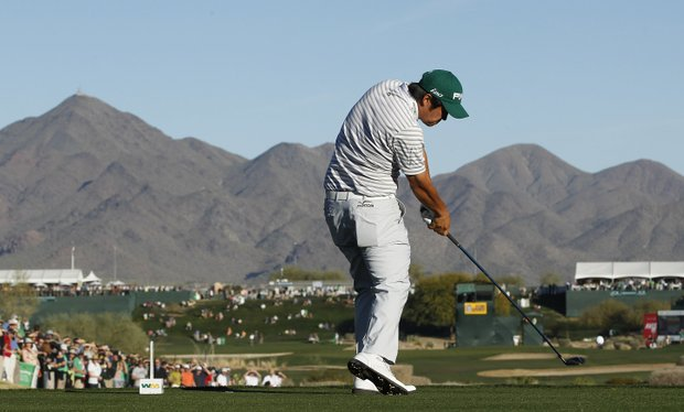 John Huh hits his tee shot at the 17th hole during the third round of the Phoenix Open golf tournament Saturday, Feb. 4, 2012, in Scottsdale, Ariz.