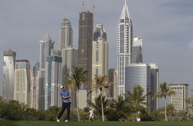 Martin Kaymer from Germany follows his shot on the 13th hole during the second round of Dubai Desert Classic, Friday, Feb. 10, 2012 in Dubai, United Arab Emirates.