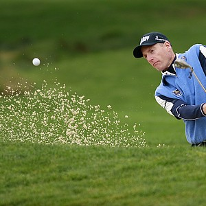 Jim Furyk hits from a bunker to the second green at Pebble Beach Golf Links during the third round of the AT&T Pebble Beach National Pro-Am golf tournament in Pebble Beach, Calif., Saturday, Feb. 11, 2012.