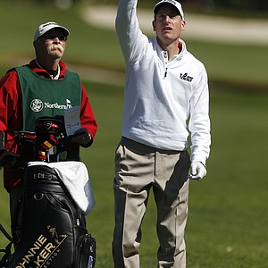 "Jim Furyk, right, throws grass into the wind as caddie Mike ""Fluff"" Cowan looks on along the third fairway during the first round of the Northern Trust Open golf tournament at Riviera Country Club in Los Angeles, Thursday, Feb. 16, 2012."