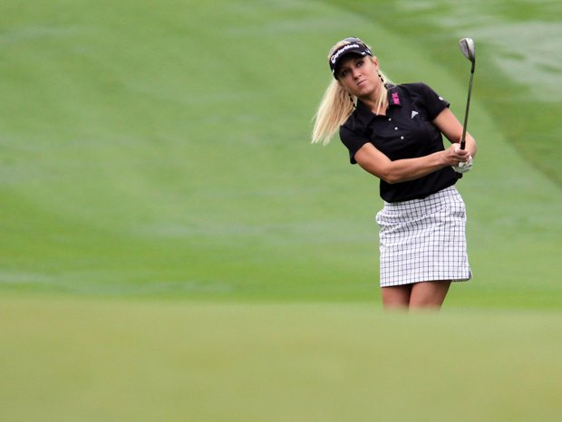 Natalie Gulbis of the U.S. plays an approach shot on the second hole during the third round of the LPGA Thailand golf tournament in Pattaya, Chonburi province, southeastern Thailand Saturday, Feb. 18, 2012.