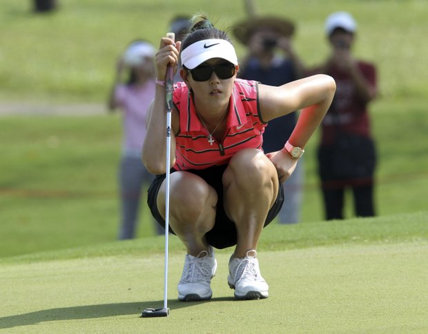 Michelle Wie of the U.S. checks putting line on the first green during the final round of the LPGA Thailand golf championship in Pattaya, Chonburi province, southeastern Thailand Sunday, Feb. 19, 2012.