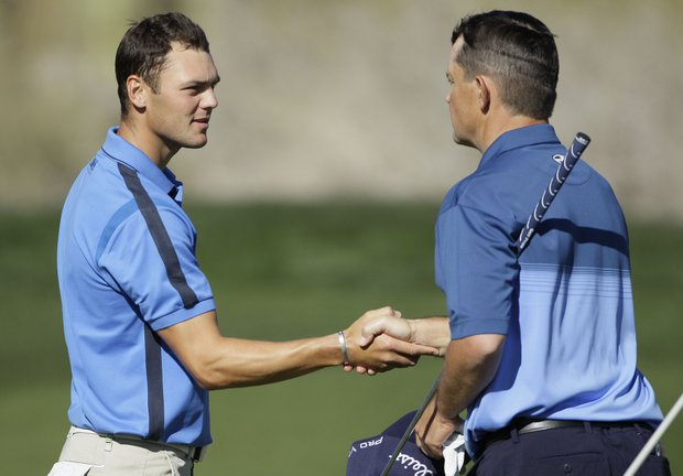 Martin Kaymer, left, of Germany, shakes hands with Greg Chalmers, of Australia, after winning their first-round match 4 and 2 during the Match Play Championship golf tournament on Wednesday, Feb. 22, 2012, in Marana, Ariz.