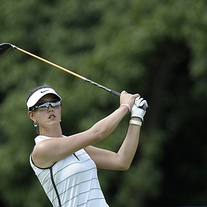 Michelle Wie of the U.S. plays on the fairway of hole 3 during round 1 of the HSBC Women's Champions golf tournament, Thursday, Feb. 23, 2012, in Singapore.